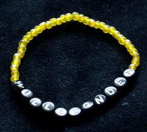 Armband enfärgad gul/svart